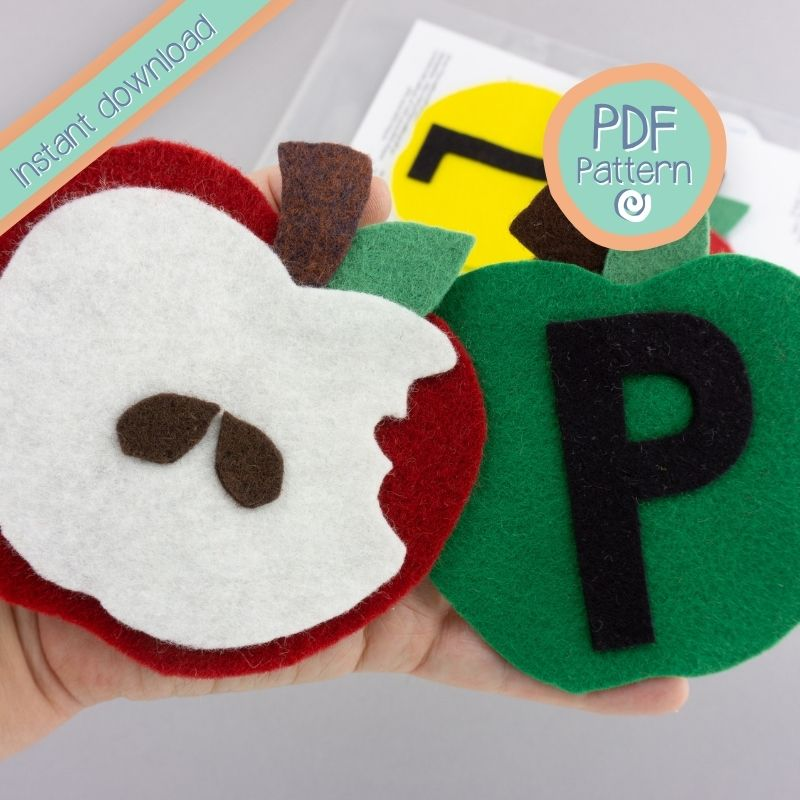 close up of felt board Apple song pieces